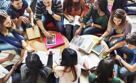 image of a group of people studying